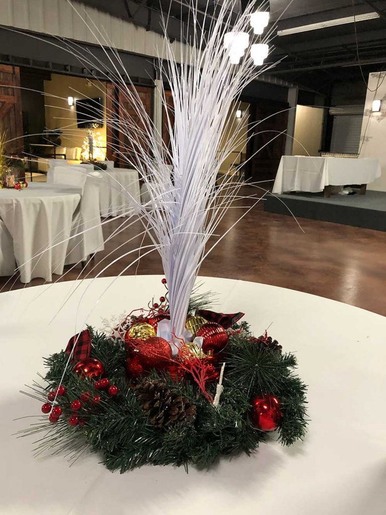 Table decor at company Christmas party at Tarrant Events Center